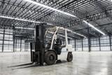 Forklift loader in large modern storehouse - 78632732
