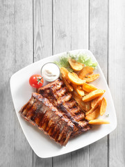 Grilled Meat, Fried Potatoes with Sauce on Plate
