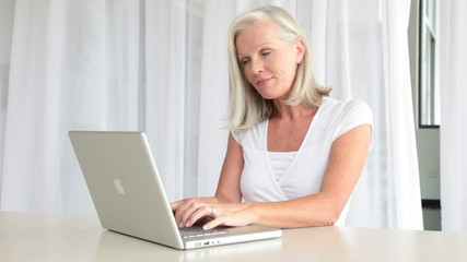 Senior woman with laptop