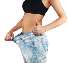 Woman with big jeans weight loss