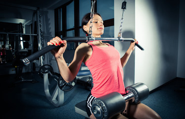 Sports background. Muscular fit woman exercising.