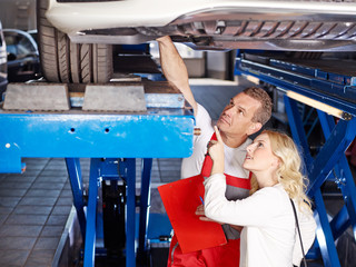 Mechanic with customer in a garage