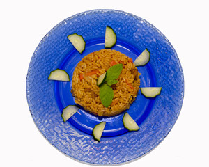 pilaf on a blue plate and isolated background