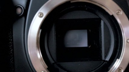 a DSLR camera mirror opening the shutter