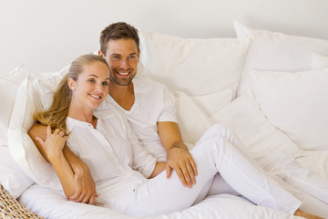 Young couple on white sofa
