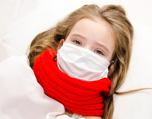 Sick little girl with surgical face mask for bacterial and virus