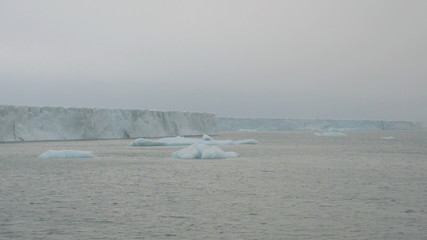 Sailing along a glacier reaching the sea 4