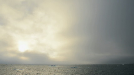 Sunlight emerging from behind the clouds over Barents sea