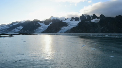 Glaciers and mountains in a fjord