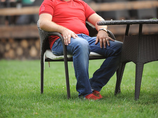 Man Sitting in Chair on Grass