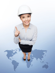 businesswoman in white helmet with finger up