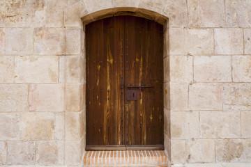 Old red brown castle door in in Castell De Montjuic,barcelona
