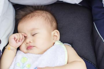 baby sleep outdoor in a baby car