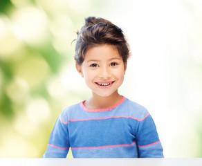 little girl over green background