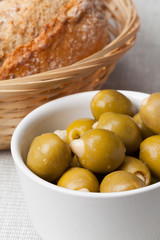 Stuffed green olives and bread.