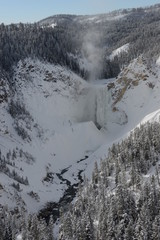Frozen waterfall in small valley