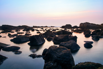 Photo of rocks in the sea.