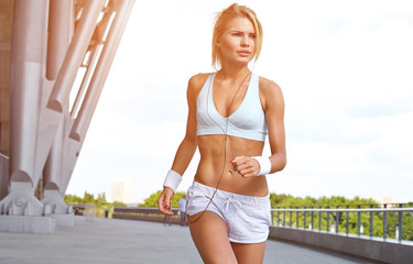 A young woman jogging on a path in a city