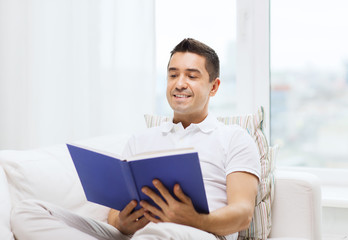 happy man reading book at home