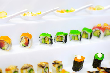 Delicious sushi with avocado topping