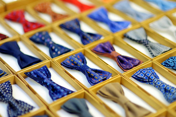 Colorful bow-ties in boxes