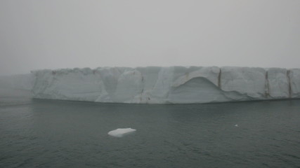 Sailing along the headland of a glacier reaching sea