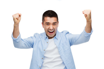 happy laughing man with raised hands