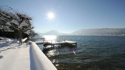 Snow covered pontoon under the sun