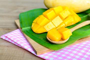 Yellow mango on wooden table
