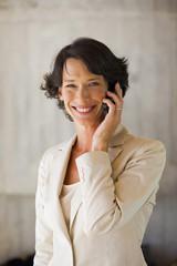 Mature businesswoman phoning