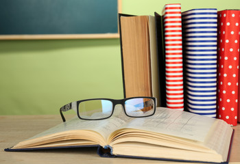 Textbooks with glasses