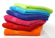 Leinwanddruck Bild - colorful stacked bathroom towels on a white background