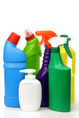 plastic cleaning bottles in various colors on a white background