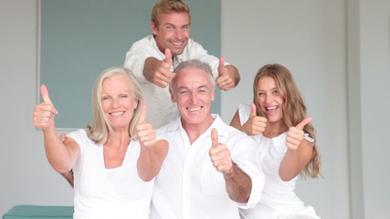 Family gesturing thumbs up