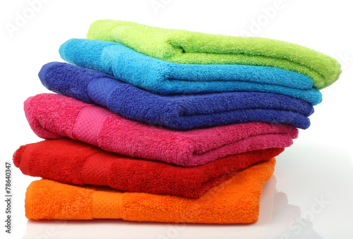 colorful stacked bathroom towels on a white background - 78640347