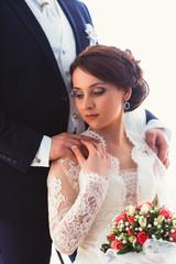 Happy bride and groom in  studio