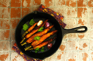 Whole baked young carrot with garlic and rosemary