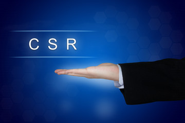 CSR or Corporate social responsibility button on blue background