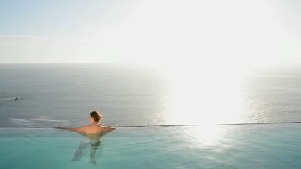 Woman in luxury swimming pool