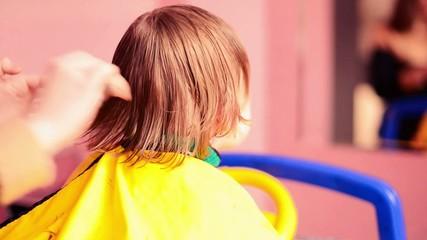 haircut in salon to a little boy