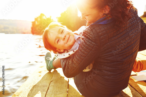 Mom and son having fun by the lake - 78641948