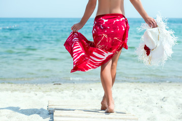 Woman walks at the beach
