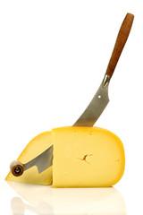 Dutch Edam cheese with a cheese cutter