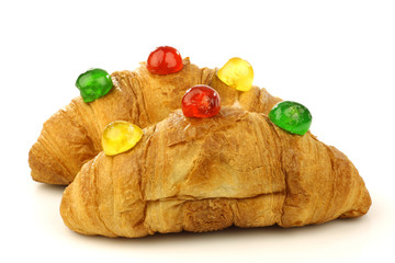 freshly baked croissants bread with colorful conserved fruits