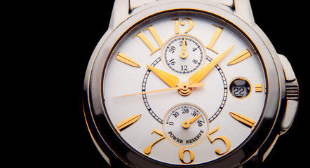 luxury white gold watch swiss made on black background