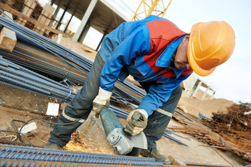 worker cutting rebar by grinding machine