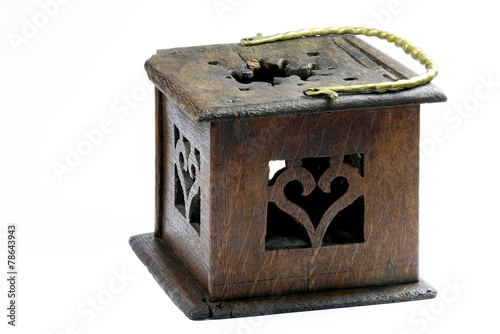 Wooden foot stove with brass handle on a white background - 78643943
