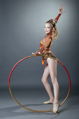 Free callisthenics. Cute young gymnast with hoop