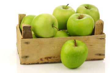 "freshly harvested ""Granny Smith"" apples in a wooden crate"
