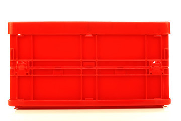 foldable red plastic storage box on a white background
